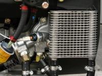 Радиатор охлаждения масла двигателя